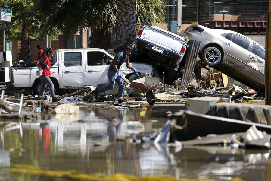 Damaged cars lie on debris after an earthquake hit areas of central Chile
