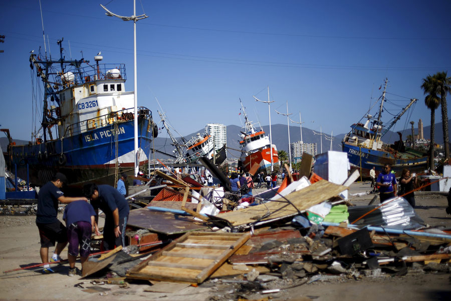 Ships are seen in the street after an earthquake hit areas of central Chile