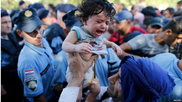 Migrants break through Croatia police lines at Tovarnik