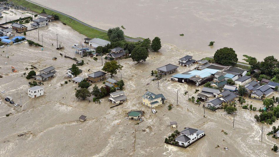 Japan floods send raging rivers through homes as thousands flee