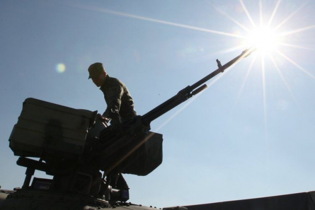Ukraine completes withdrawal of tanks on all fronts
