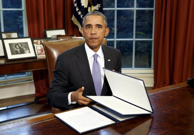 """U.S. President Obama looks up after his veto of H.R. 1735 """"National Defense Authorization Act for Fiscal Year 2016"""" in the Oval Office of the White House in Washington"""