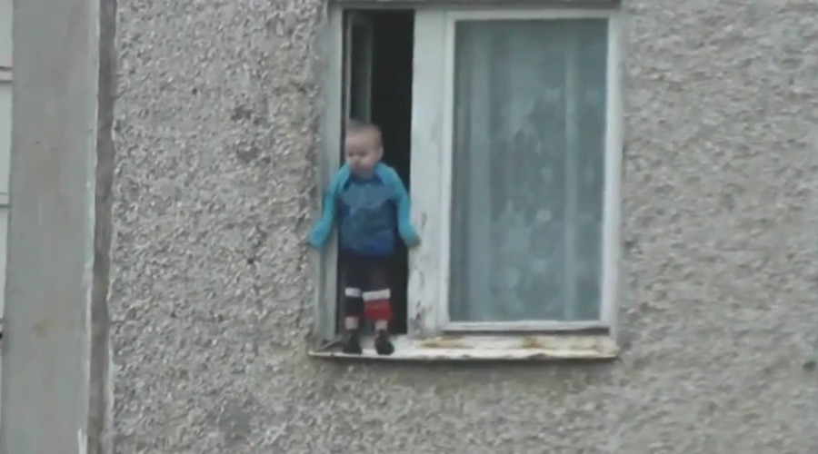 Worst parents ever? Russian toddler hangs out of 8th floor window