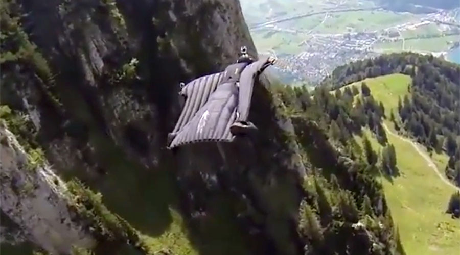 Death defying birdman almost crashes into stone wall, parachute lines become tangled (VIDEO)