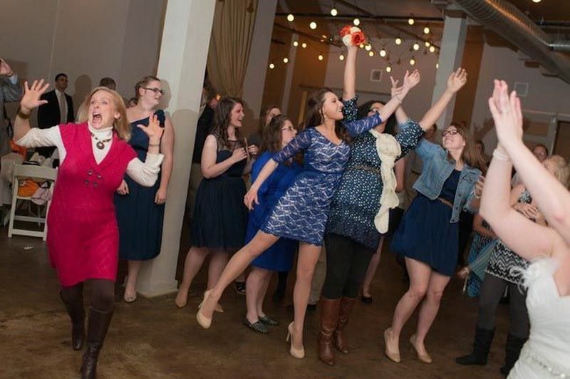 Woman Trying To Catch Wedding Bouquet (photos)
