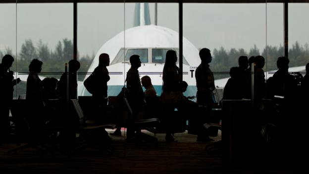 [UNVERIFIED CONTENT] Passengers inside a terminal at Changi airport in Singapore are lining up to board a Cathay Pacific 747-400 airplane bound for Hong Kong.