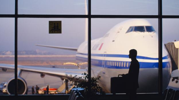 Silhouette of businessman in airport