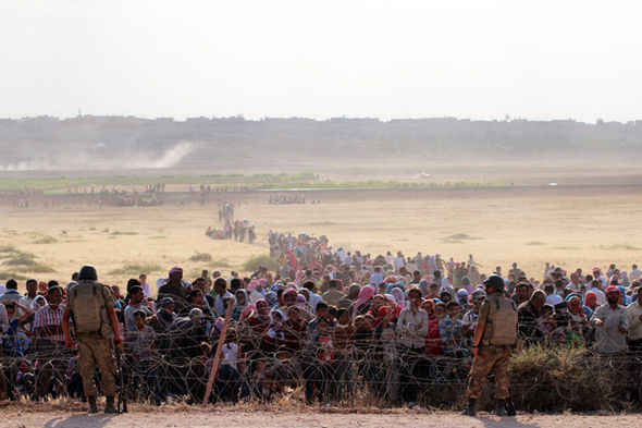 refugees-525360