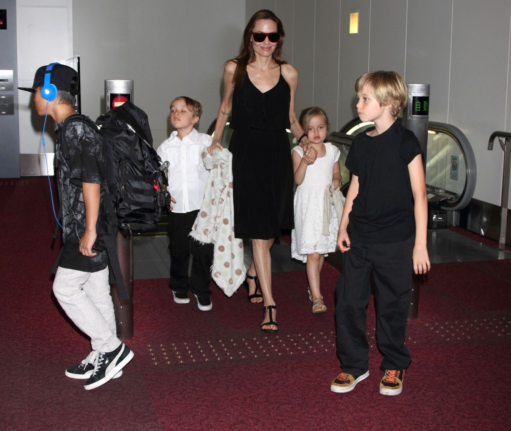 Mandatory Credit: Photo by Masatoshi Okauchi/REX/Shutterstock (3854763g) Angelina Jolie and children Pax Jolie-Pitt, Knox Jolie-Pitt, Vivienne Jolie-Pitt and Shiloh Jolie-Pitt Angelina Jolie and family at Haneda International airport, Tokyo, Japan - 21 Jun 2014 Angelina Jolie and family arrives in Japan to attend the Japanese premiere of the movie 'Maleficent', which will be released on July 5th