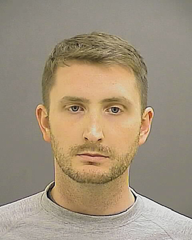 Officer Edward M. Nero is pictured in this undated booking photo provided by the Baltimore Police Department.  Baltimore Police Department/Handout via Reuters