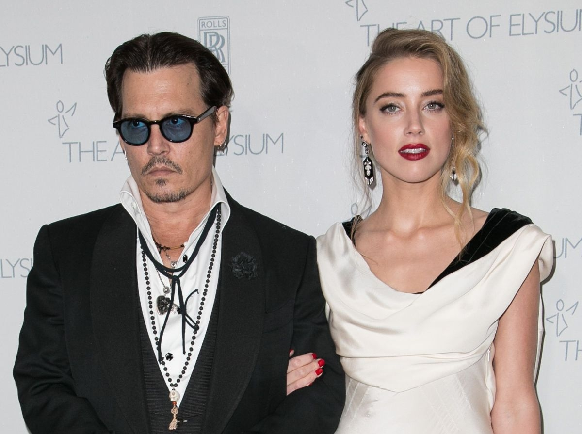 Johnny Depp's wife Amber Heard files for divorce after 15-month marriage, reports say