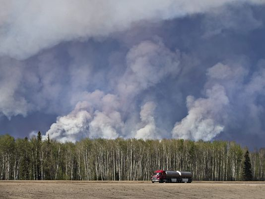 Evacuee convoys to dash down fire-besieged highway in Canada