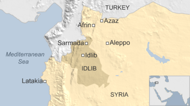 Syria conflict: Air strike on refugee camp 'kills dozens'