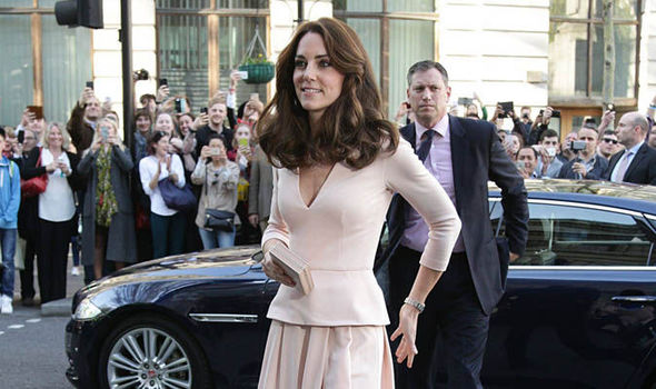 Pretty in pink: Stylish Kate sees glamorous Vogue shots at National Portrait Gallery event