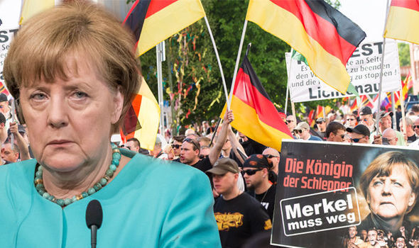 Enraged German protesters DEMAND 'Merkel MUST GO' following liberal immigration policies
