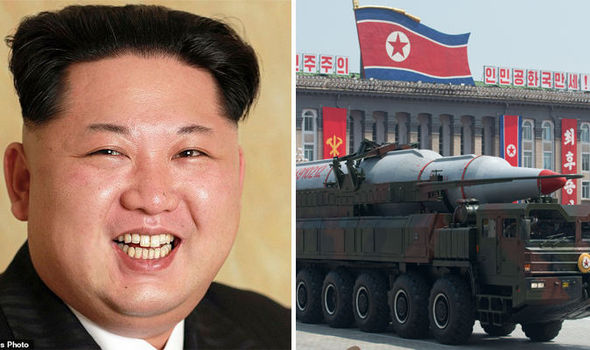 Candid Kim: North Korea releases UNTOUCHED photos of grinning tyrant for the first time