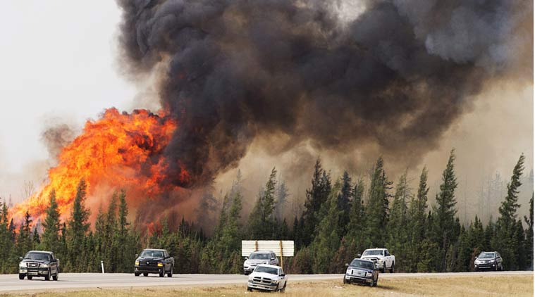 Canada wildfire: Oil workers evacuate camps near Fort McMurray