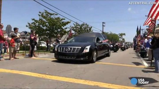 Thousands line streets to mourn fallen Navy SEAL