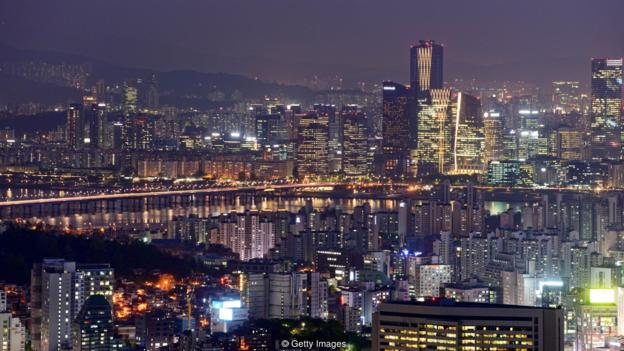 A photo taken on May 9, 2014 shows a general view of the Seoul city skyline at dusk. The global cost of securing a clean energy future is rising by the year, the International Energy Agency (IEA) warned on May 12, 2014, estimating that an additional 44 trillion USD of investment was needed to meet 2050 carbon reduction targets. Releasing its biennial