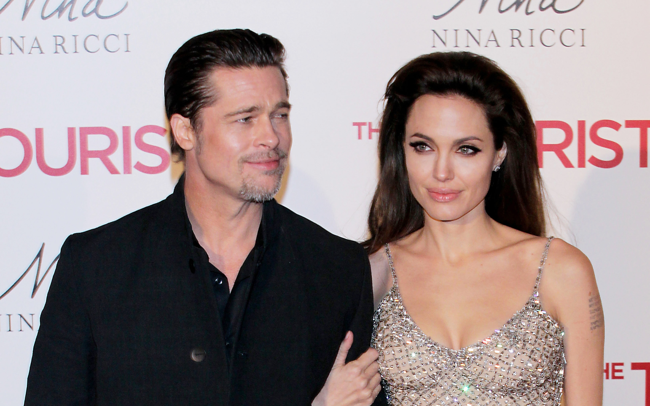 Brangelina Divorce? Brad Caught Kissing Another Woman!