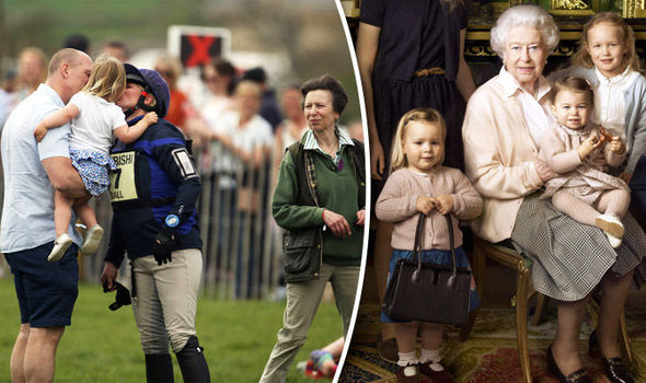 Royal day out: Zara gets kiss from Mia as she supports mum at races with the whole family