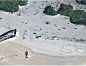 SOS in the sand: pair found by US navy after week-long stranding in Pacific