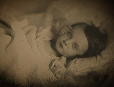 Unsettling Victorian portraits of dead children propped up to look alive