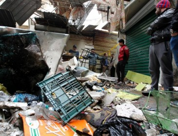 Iraq: At least 21 people killed as two bombs strike Baghdad market