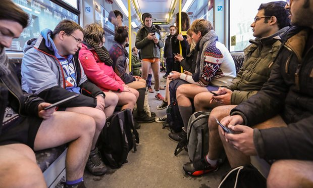 Travellers cast off inhibitions on no pants subway ride day – in pictures