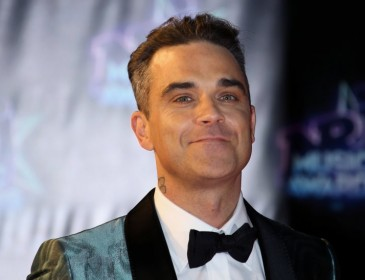 Robbie Williams management accused of selling gig tickets on resale sites for £65 more